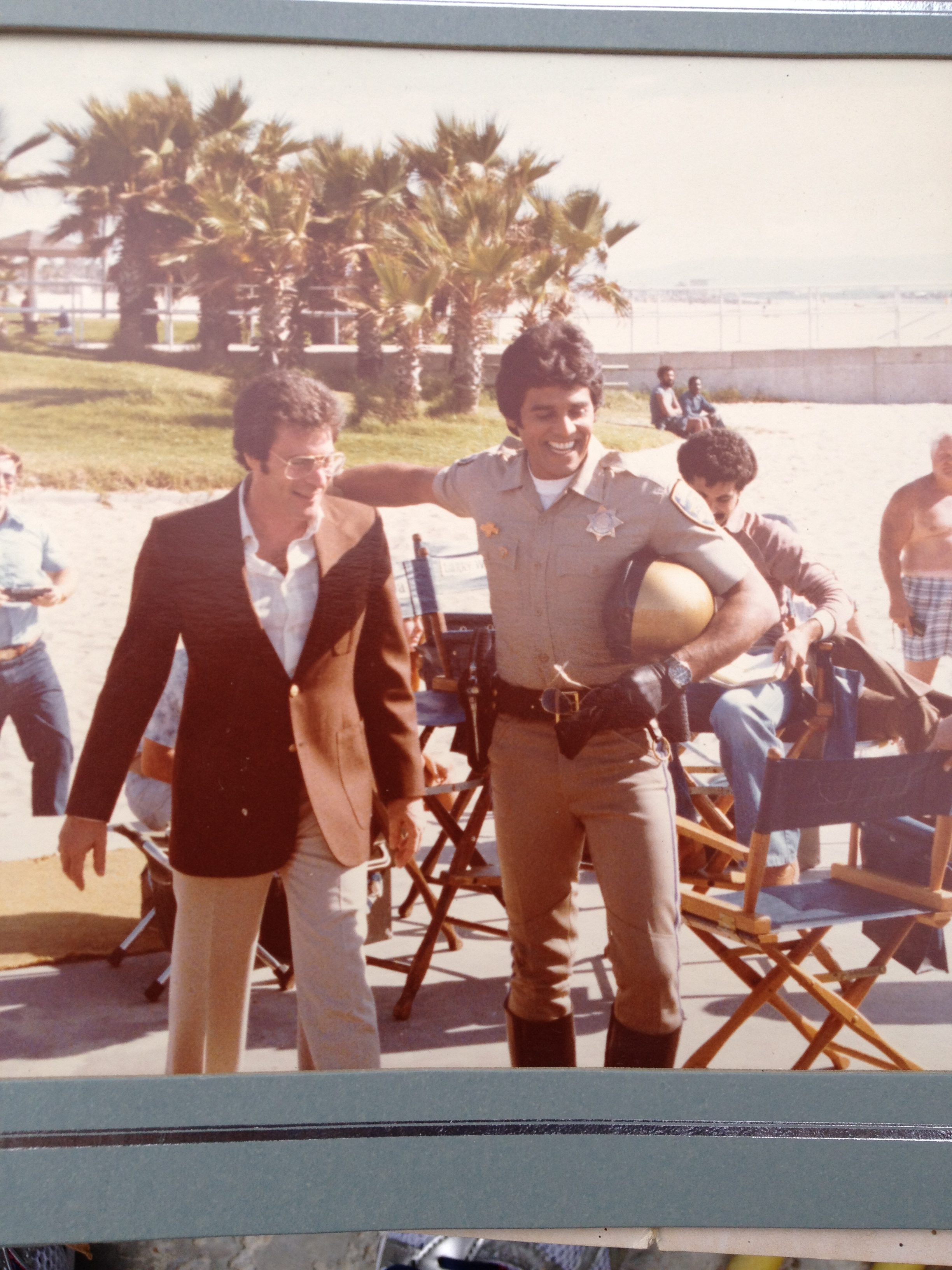 Photograph of Erik Estrada on the film set of television show CHiPs in Los Angeles California in the early 1980's.